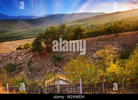 dramatic hdr sunset in bulgarian mountain highlands - Stock Photo