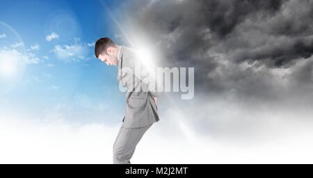 Man blocking Grey sky and blue sky weather change surreal transition - Stock Photo