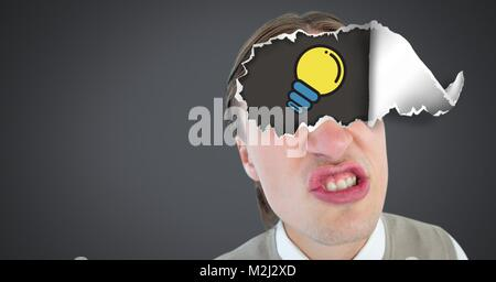 Man with torn paper on eyes and lightbulb - Stock Photo