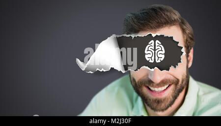Man with torn paper on eyes and brain drawing - Stock Photo