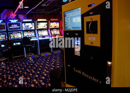 Fruit machines, Fixed Odds Betting Terminals, gambling machines, slot machines in amusement arcade UK - Stock Photo
