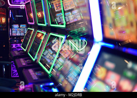 Fruit machines, gambling machines, slot machines concept, abstract in amusement arcade UK - Stock Photo