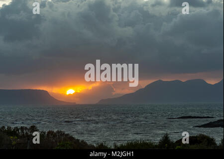 Sunsets between Eigg and Isle of Rum from Mallaig Scottish highlands