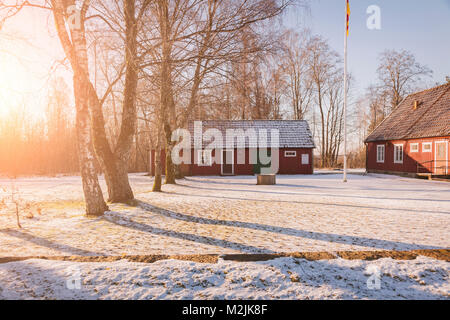 Traditional swedish farm buildings. in red wood. - Stock Photo