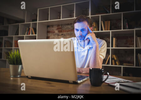 Young man with a laptop - Stock Photo