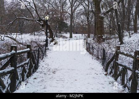 Snow bridge in new york, central park. - Stock Photo