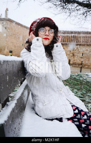 Young cute woman enjoying a snowy day - Stock Photo