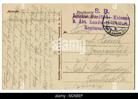 Back of historical German postcard (M2K8D9) with letter written in pencil, with field mail and name of military - Stock Photo