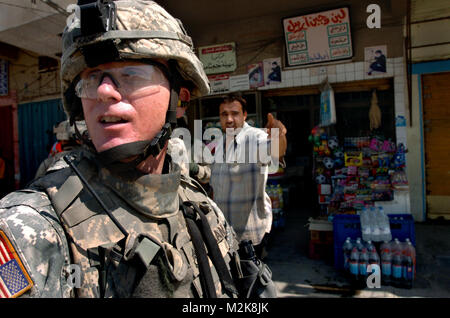 060703-N-7586B-121  U.S. Army Sgt. 1st Class Joe Kane patrols the streets in East Baghdad, Iraq, on July 3, 2006. - Stock Photo