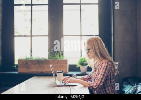Side profile half-faced photo of busy concentrated smart clever beautiful woman wearing checkered shirt and glasses, - Stock Photo