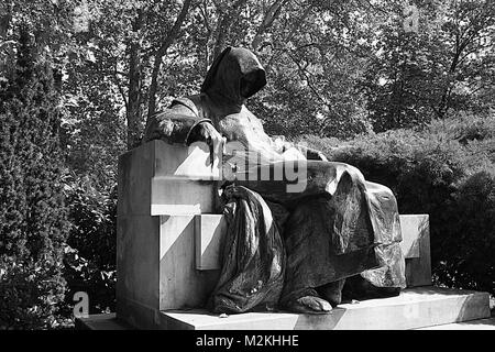 Anonymous monk statue in Budapest - Stock Photo