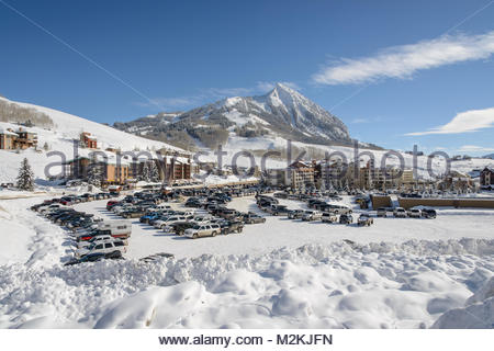 Crested Butte Mountain ski area from the base area parking lot on a perfect winter day. - Stock Photo