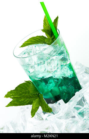 Iced green peppermint syrup with tonic water and ice cubes. Isolated on white background. - Stock Photo