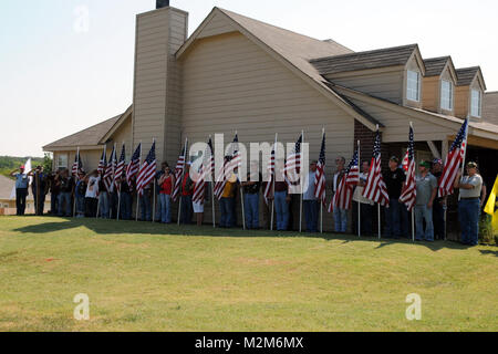 Soldiers and civilians gather to honor Staff Sgt. Kirk Owen in Supulpa, Okla., July 14.  Owen was a squad leader - Stock Photo