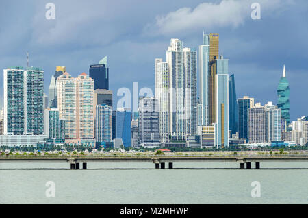 Panama City, Panama - November 3, 2017: Skyline of Panama City on a cloudy day with modern buildings, the F&F Tower, - Stock Photo