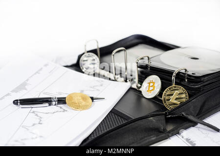 Abstract cryptocurrency photo. Some crypto coins on documents. - Stock Photo