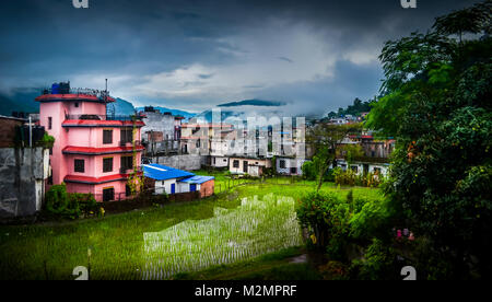 view from balcony of the hotel overlooking residential units in Besisahar in Nepal after completion of Annapurna - Stock Photo