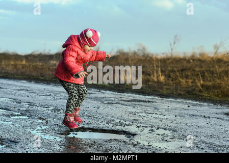 Little girl jumping in water, flying, unforgettable moments, fun with father, village life. Concept - happy childhood - Stock Photo