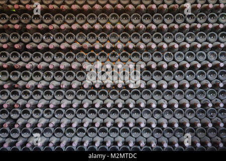 La Geria, Lanzarote - 8th Nov 2017. A row of old bottles on display at a family run winery called Bodega La Geria - Stock Photo
