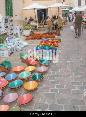 SANTANYI, MALLORCA, SPAIN ON NOVEMBER 2, 2013: Colorful ceramics displayed on the Santanyi market on an overcast - Stock Photo