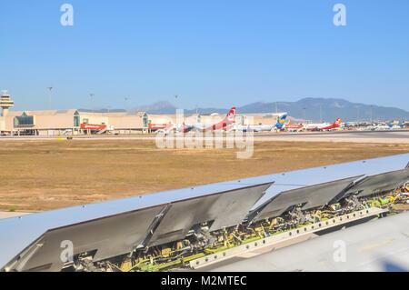 PALMA, MALLORCA, SPAIN ON JULY 11, 2014: Landing breaks. Airline wing with landing break mechanics on a sunny summer - Stock Photo
