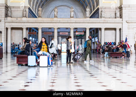 Washington DC, USA - October 27, 2017: Inside Union Station in capital city with transportation signs and people - Stock Photo
