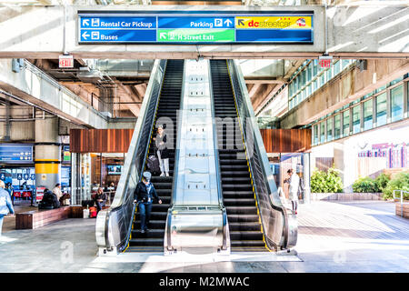 Washington DC, USA - October 27, 2017: Inside Union Station escalator to garage parking for buses in capital city - Stock Photo