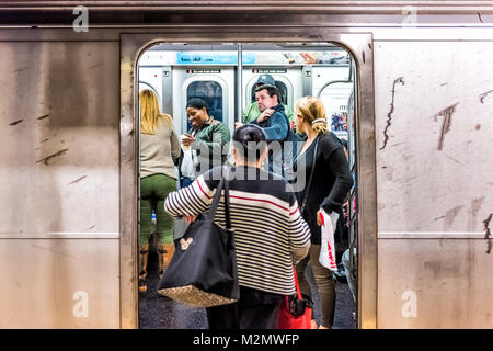 New York City, USA - October 28, 2017: People in underground platform transit in NYC Subway Station on commute with - Stock Photo