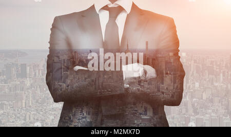Double exposure of success business man with arms crossed and city in background. Concept businessman lifestyle - Stock Photo