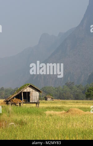 Small Rice Barn in a ricefield in a mountain region of Laos - Stock Photo