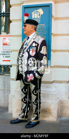 Colour Photograph of a man in a Pearly Suit at Covent Garden, Central London, England, United Kingdom, Credit: London - Stock Photo