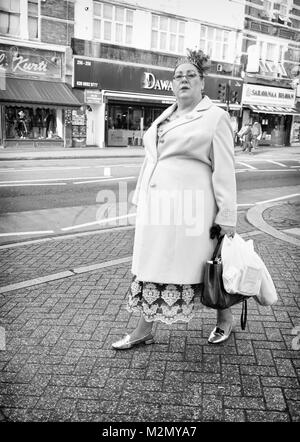 Black & White Photograph of a woman shopping in Tooting High Street, London, England. UK, Credit: London Snapper - Stock Photo