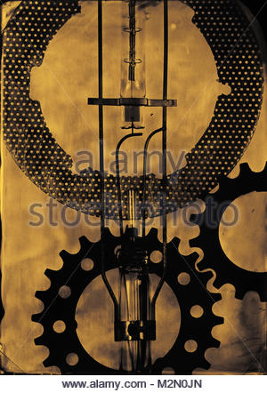 Tintype of gears, found objects and discarded bicycle parts. Close up silhouette of still life objects. - Stock Photo