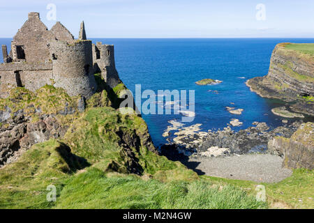 Dunluce Castle (Irish: Dun Libhse), a now-ruined medieval castle located on the edge of a basalt outcropping in - Stock Photo