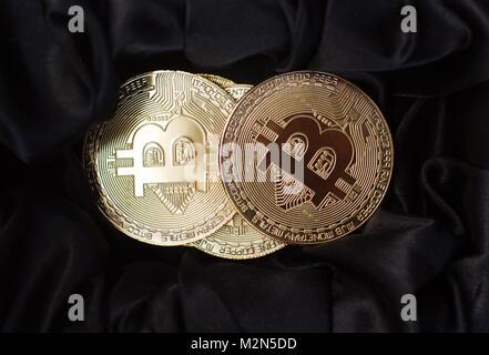 horizontal top view closeup of bitcoin golden metallic coins on black velvet background - Stock Photo