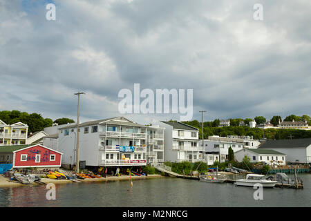 Upper Peninsula Michigan, Famous Mackinac Island in summer, downtown Lake Huron shoreline with colorful kayaks, - Stock Photo