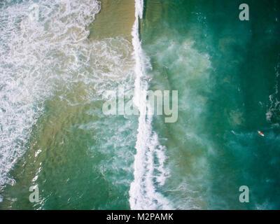 Drone photo of Barra da Tijuca beach, Rio de Janeiro, Brazil.We can see the waves  crashing on the ocean in Barra - Stock Photo