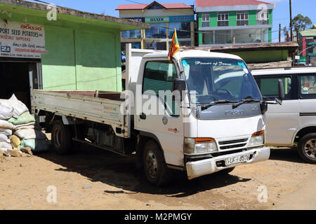 Nuwara Eliya Hill Country Central Province Sri Lanka Truck with broken Bumper outside Wholesale Suppliers - Stock Photo