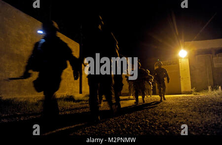 Medical and security personnel from Provincial Reconstruction Team Zabul leave the gate of Forward Operating Base - Stock Photo