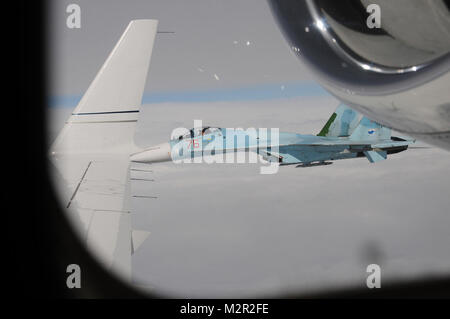 A Russian SU-27 Flanker, flying from Petropavlovsk-Kamchatski, intercepts Fencing 1220, a suspected hijacked aircraft - Stock Photo