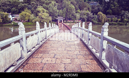 Vintage toned picture of the bridge in the Jade Spring Park in Lijiang, China. - Stock Photo