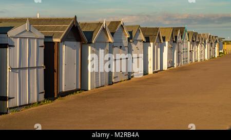 Beach huts on the promenade, seen in Shoeburyness, Southend-on-Sea, Essex, England, UK - Stock Photo