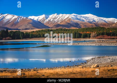 Stunning landscape views of Southern Alps and Lake Tekapo, Mackenzie Country, New Zealand - Stock Photo