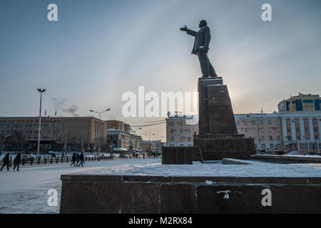 A statue of Lenin in Yakutsk, in Siberia. Yakutsk is the second coldest major city in the world after Norilsk. - Stock Photo