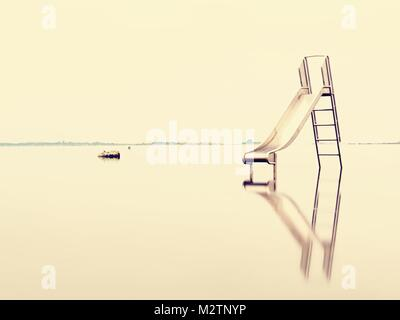 Sunset shore and old steel slide in lake. Chrome ladder tower with  sliding track, big granite stones around.  End - Stock Photo