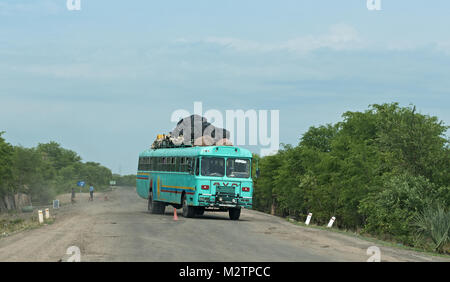 bus on the M10 road between Kazungula and Sesheke in southern Zambia parallel to the Zambezi River - Stock Photo