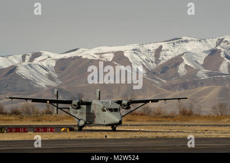 A C-23 Sherpa from Detachment 3, A Company, 641 Aviation Regiment out of Rapid City, South Dakota, returns to Provo - Stock Photo