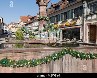 Germany, Baden-Wurttemberg, Gernsbach in the Black Forest, the market fountain in the centre is decorated for Easter - Stock Photo