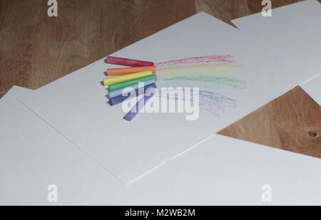paper and crayons for drawing on the wooden table - Stock Photo