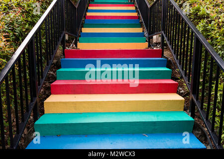 Stairs painted in rainbow colors background - Stock Photo
